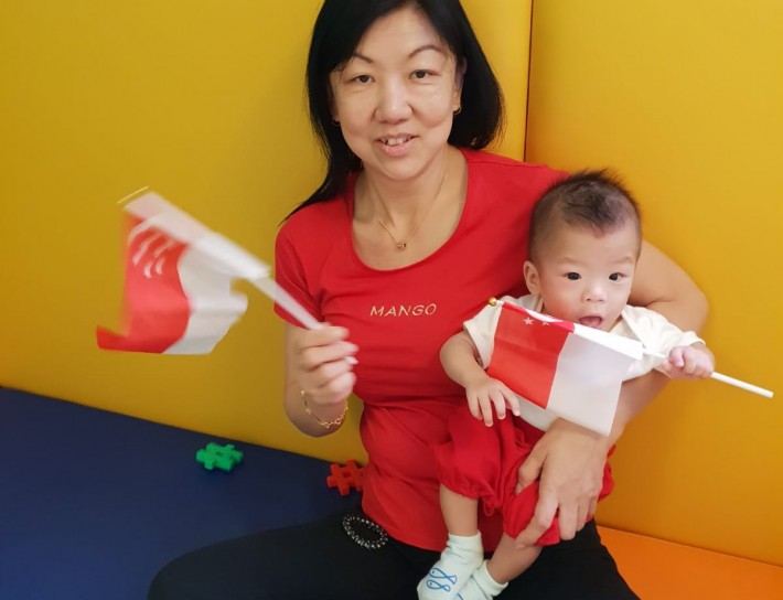 Infant and Teacher on National Day